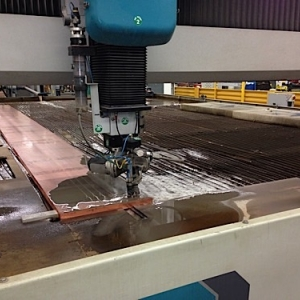 water jet cutting machine cutting a dc copper bus bar